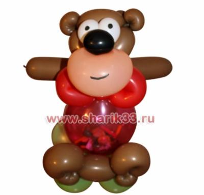Мишка с конфетками в пузике